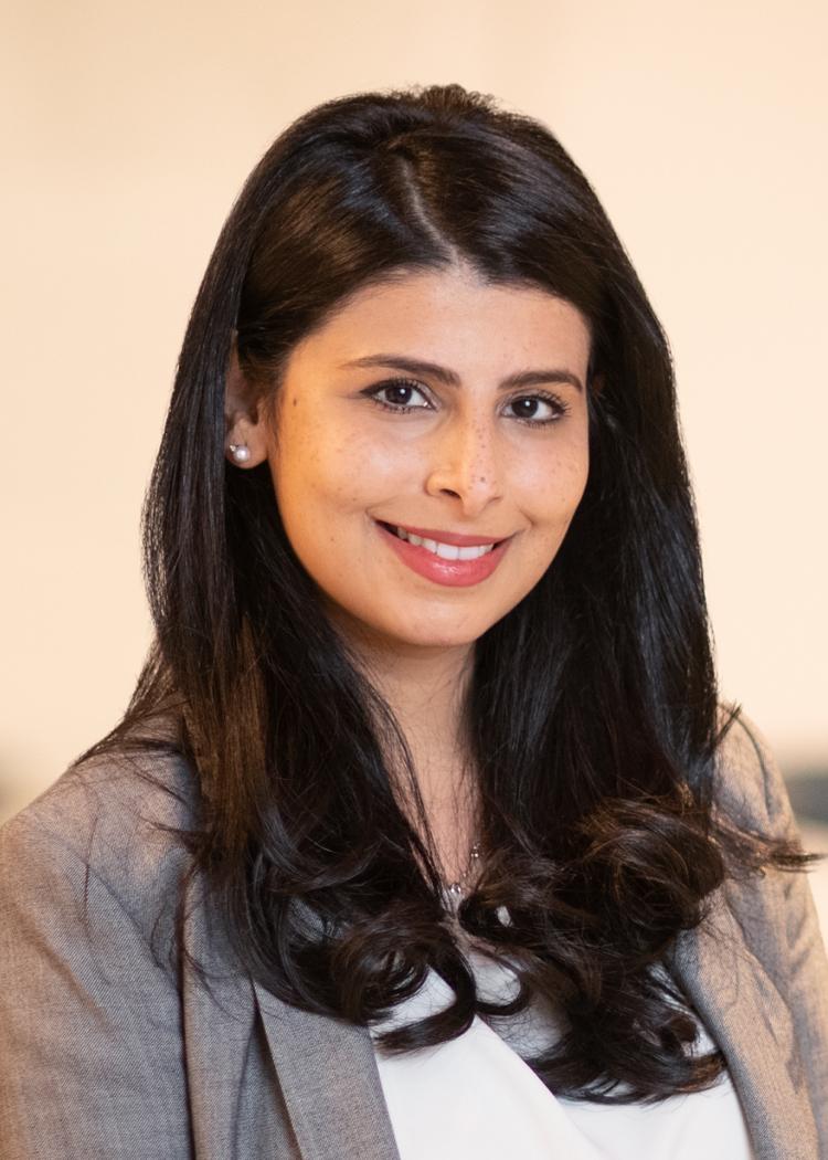 Mehreen Imtiaz standing in an office wearing a blazer